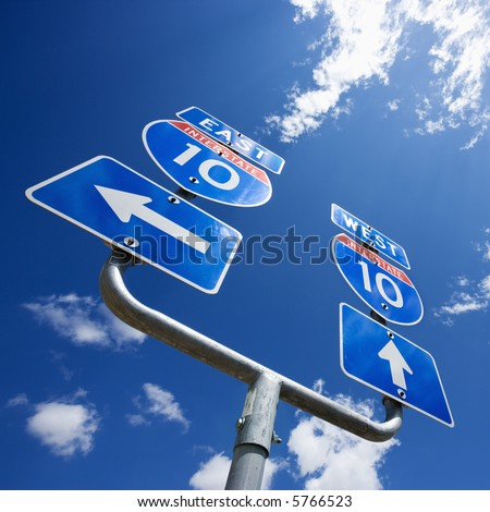 Highway interstate 10 sign with arrows showing direction. - stock photo
