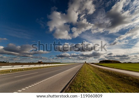 Highway - landscape of autumn in Lithuania, location near Siauliai. - stock photo