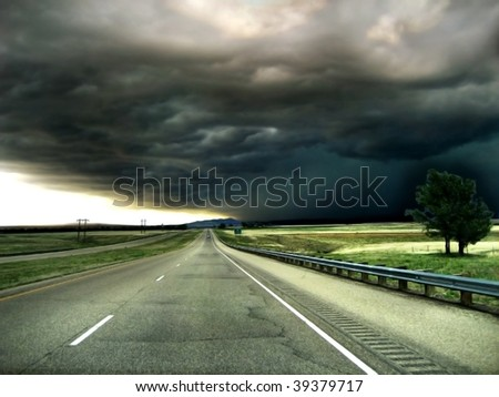 Highway leading into a Storm on the Horizon Background - stock photo
