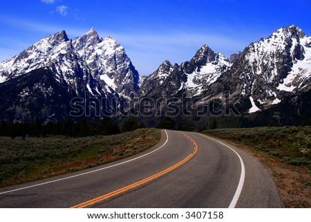 Highway leading to the Teton's, Grand Teton National Park, Wyoming - stock photo