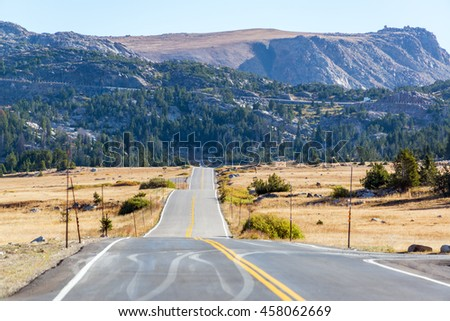 Highway leading to wilderness in the Shoshone National Forest and the Beartooth Mountains in Wyoming - stock photo