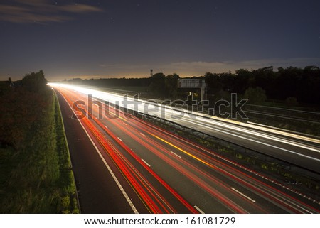 highway light trails at night - stock photo