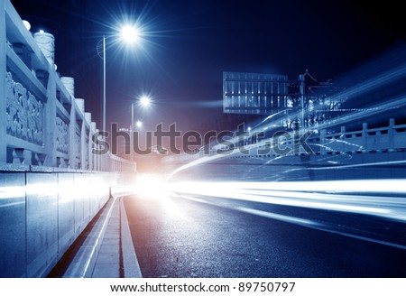 Highway light trails, modern city at night.