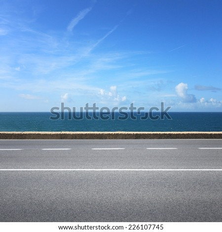 Highway on sunny summer day with view to water - stock photo