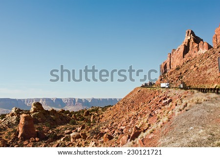 Highway on the edge of a steep cliff with two trucks passing each other.  - stock photo