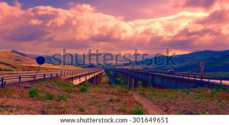 Highway on the Island of Sicily in Italy at Sunset - stock photo