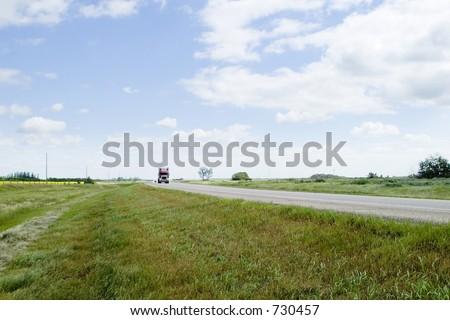 Highway on the prairies - stock photo