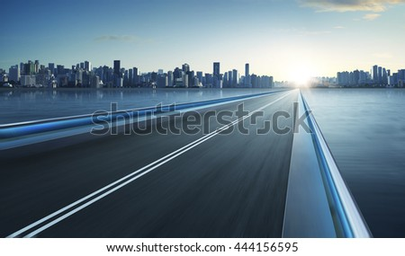 Highway overpass motion blur with city skyline background . cold mood . - stock photo