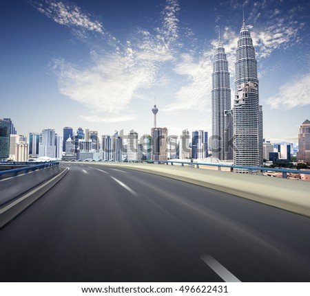 Highway overpass motion blur with kl city background