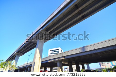 Highway overpass on blue sky background