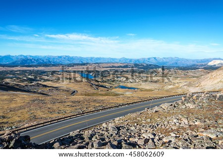 Highway passing through a dramatic alpine landscape in the Beartooth Mountains in Montana - stock photo