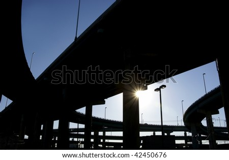 Highway ramps in silhouette - stock photo