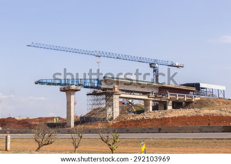 Highway Road Construction Crane  Highway construction crane inter section junction cross over on off ramps concrete columns above roads