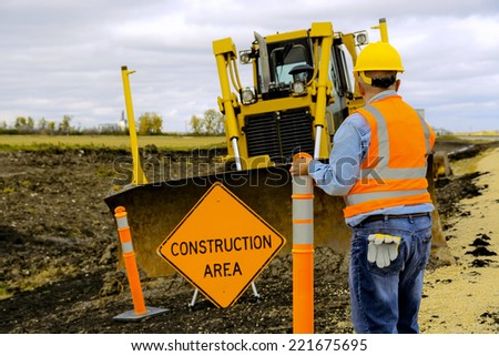 Highway Road construction worker - stock photo