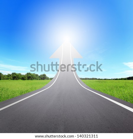 highway road going up as an arrow, copy space in the image are great for your design - stock photo