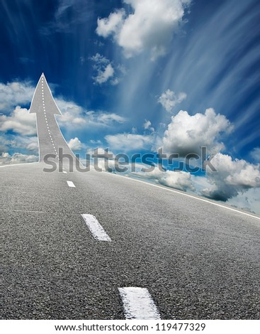 highway road going up as an arrow over blue cloudy  sky - stock photo
