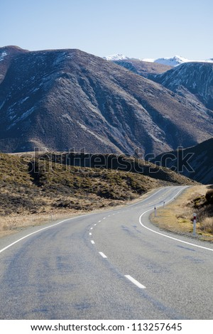 Highway road to Crown range Arrow town Southern Alps mountain valleys New Zealand