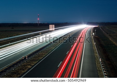 Highway road with traffic at night