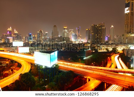 Highway roads and city skyline - stock photo