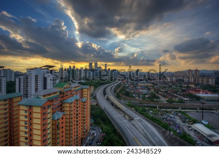 Highway roads towards to the cities captured during sunset from rooftop of building  with dramatic clouds on the sky (soft focus, shallow DOF, slight motion blur)  - stock photo