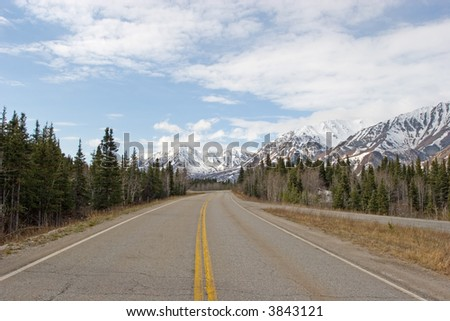 Highway running by the Alaska Range - stock photo