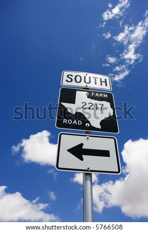 Highway sign denoting south Texas farm road with arrow. - stock photo