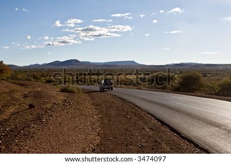 Highway, southern African landscape. South-East of Kalahari Desert Botswana. - stock photo