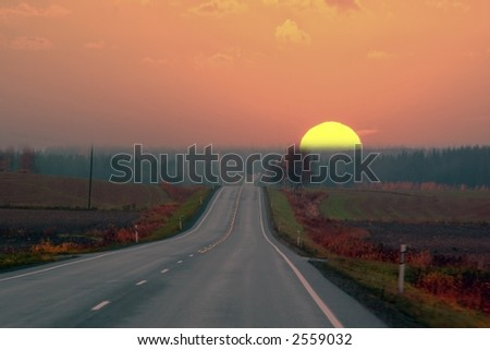 Highway sunset - stock photo