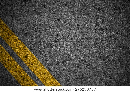 Highway surface with two yellow lines. Asphalt background - stock photo