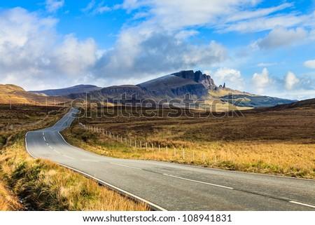 Highway through a desolate landscape in Scotland - stock photo