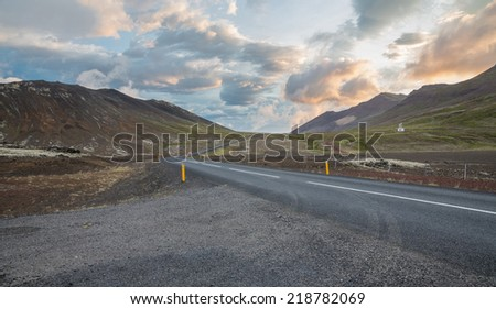 Highway through Iceland landscape with car