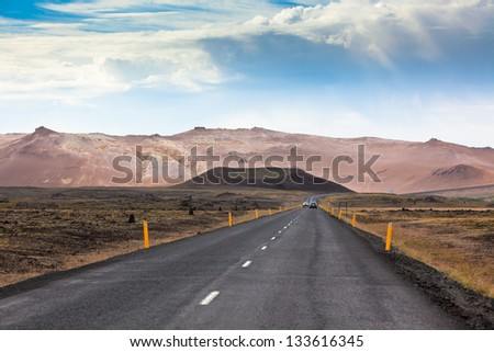 Highway through Iceland Mountains landscape. Hverir sulfuric springs. Horizontal shot - stock photo