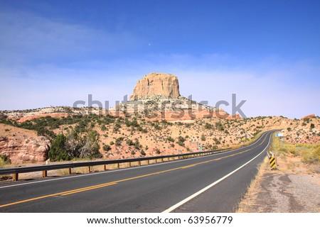 Highway through northern Arizona's desert region on Navajo Indian reservation land - stock photo