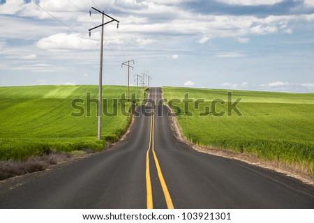 Highway through wheat fields in Washington State - stock photo