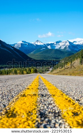 Highway to the mountains - stock photo