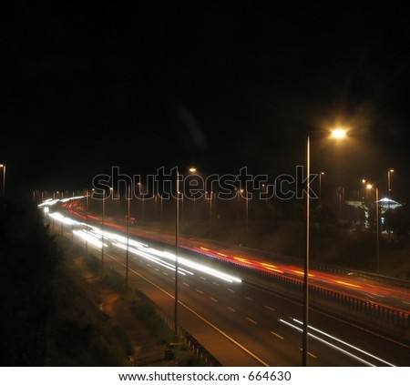 Highway Traffic at Night -- on a six lane expressway