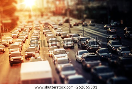 Highway Traffic at Sunset. Tilt Shift Concept Photo. Traffic in Las Vegas Nevada, USA. - stock photo