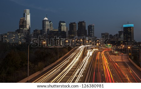 Highway traffic leading into and out of Philadelphia an night. - stock photo