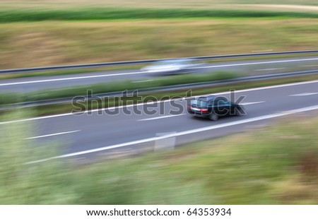 highway traffic (motion blurred image, color toned image) - stock photo