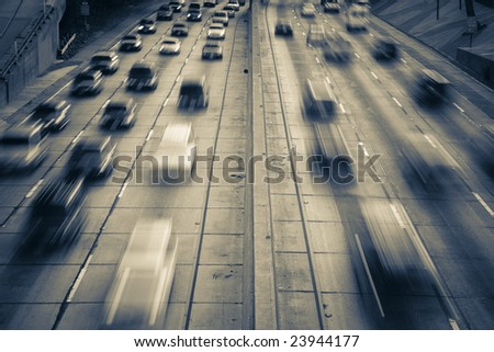 Highway traffic (time lapse with traffic as motion blur) - stock photo