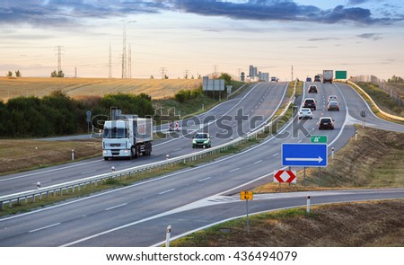 Highway transportation with cars and Truck - stock photo