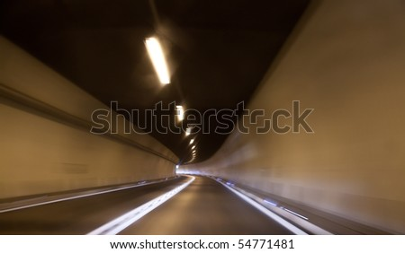 highway tunnel with motion blur - stock photo