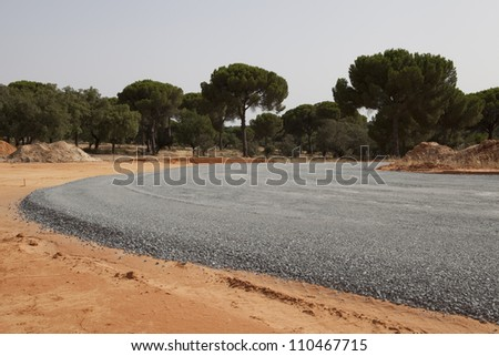 Highway under construction -new asphalt pavement works - stock photo