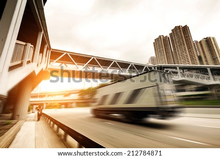 Highway viaduct and people of Hong Kong Bank - stock photo