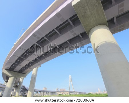 Highway viaduct in modern city - stock photo