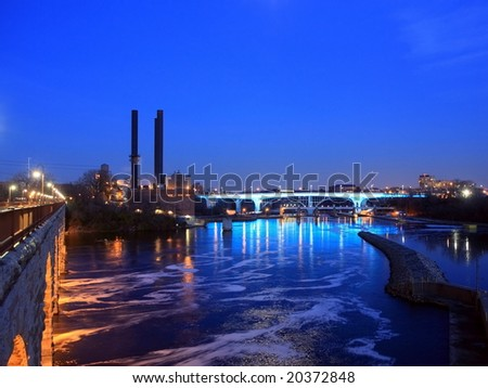 Highway 35W bridge over Mississippi river in Minneapolis, view from Stone Arch bridge - stock photo