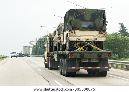 Highway 90/94,  Wisconsin - July 07 : Military vehicles being relocated from one base to another in the middle of the Jade Helm 15 exercise , July 07 2015 on highway 90/94, Wisconsin