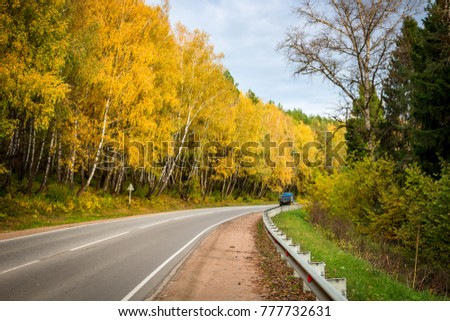Highway with a beautiful turn. Autumn palette