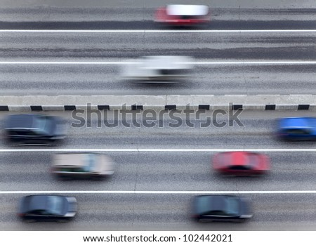 Highway with traffic car in motion - stock photo