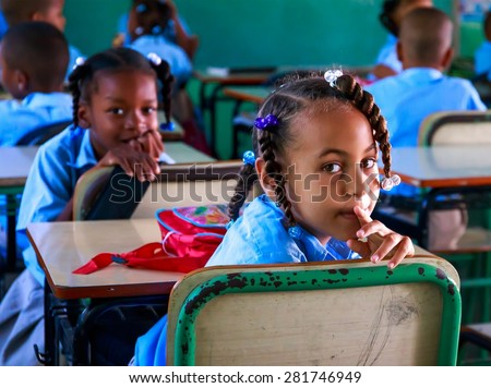 HIGUEY, DOMINICAN REPUBLIC - NOVEMBER 19, 2014: unidentified children during brake at dominican school. - stock photo
